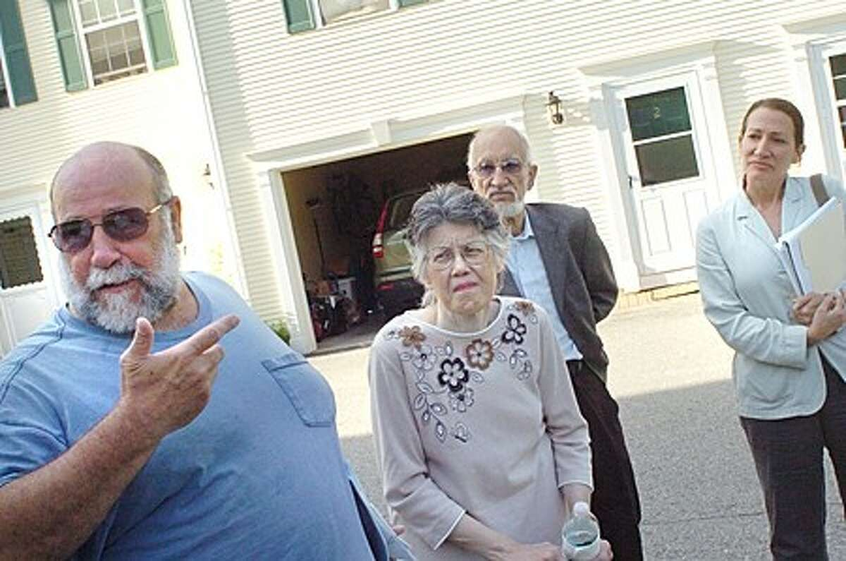 Residents of Woodfield Commons, John and Marlene Saviano along with Norwalk residents John Lombardi and Diane Lauricella express concerns over the Zoning Commision in the area of Norden Place. hour photo/matthew vinci