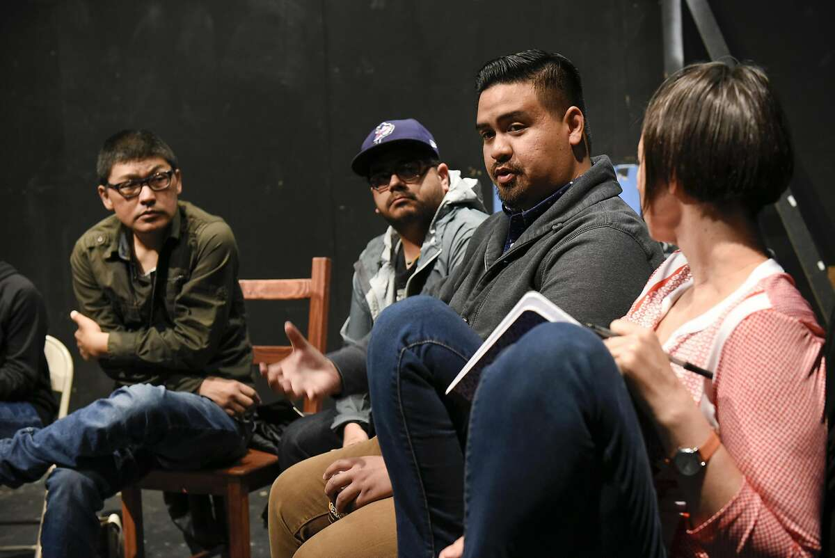 Actor Jeffery Lo speaks at a meeting of the TheatreFirst company at Live Oak Theatre.