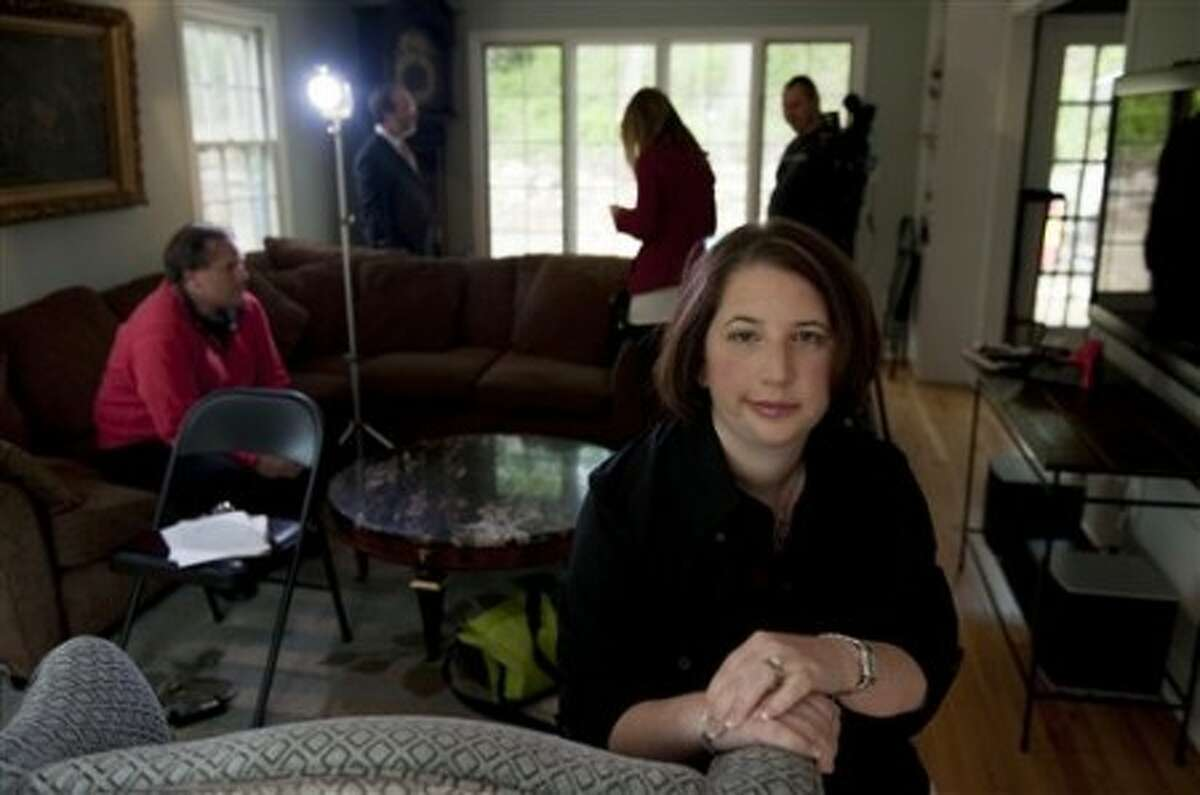 Pamela Fink says in discrimination complaints filed this week that MXenergy of Stamford hired someone else for her duties while she was recovering from a preventative double mastectomy, then fired her shortly after she returned.