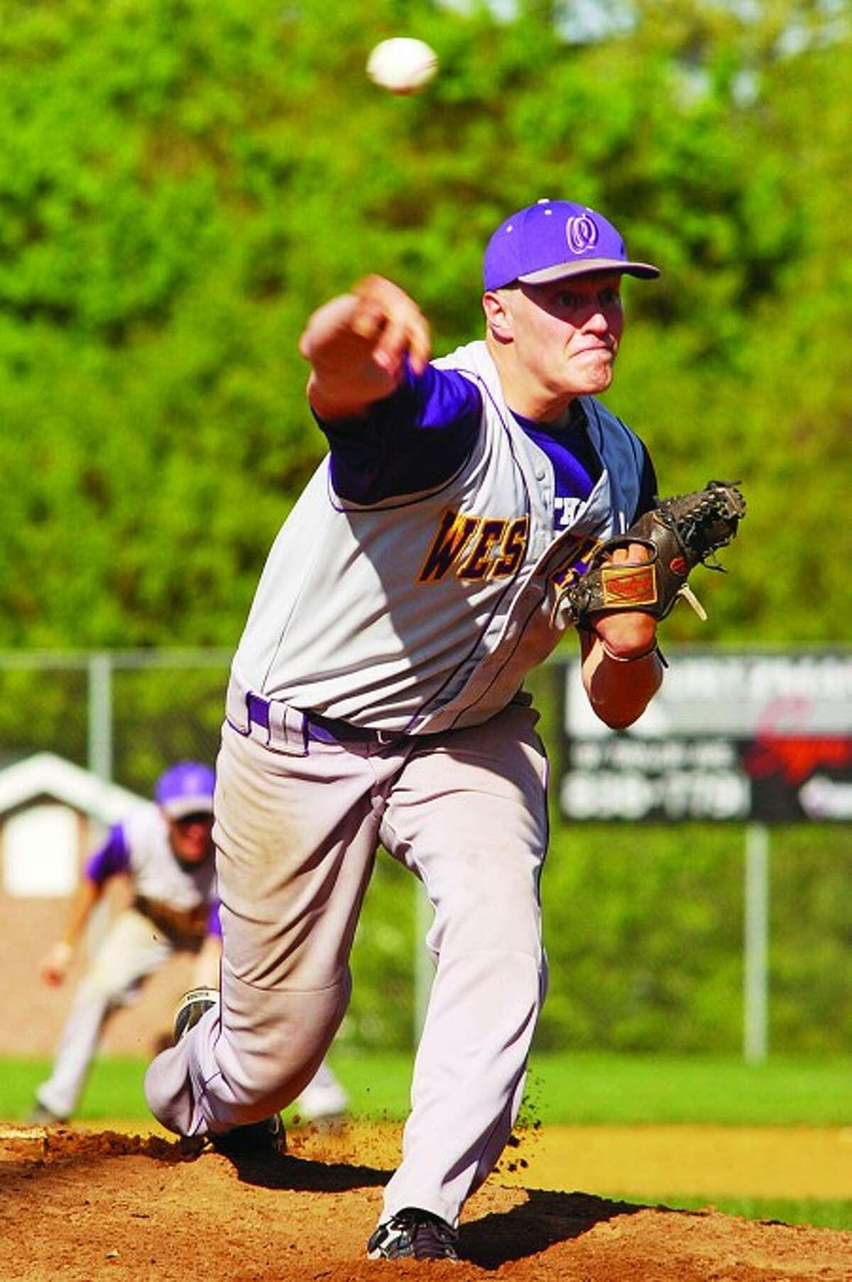Westhill starting pitcher Morgan Williams is about to throw a pitch against McMahon on Friday, April 30. Times photo/Erik Trautmann