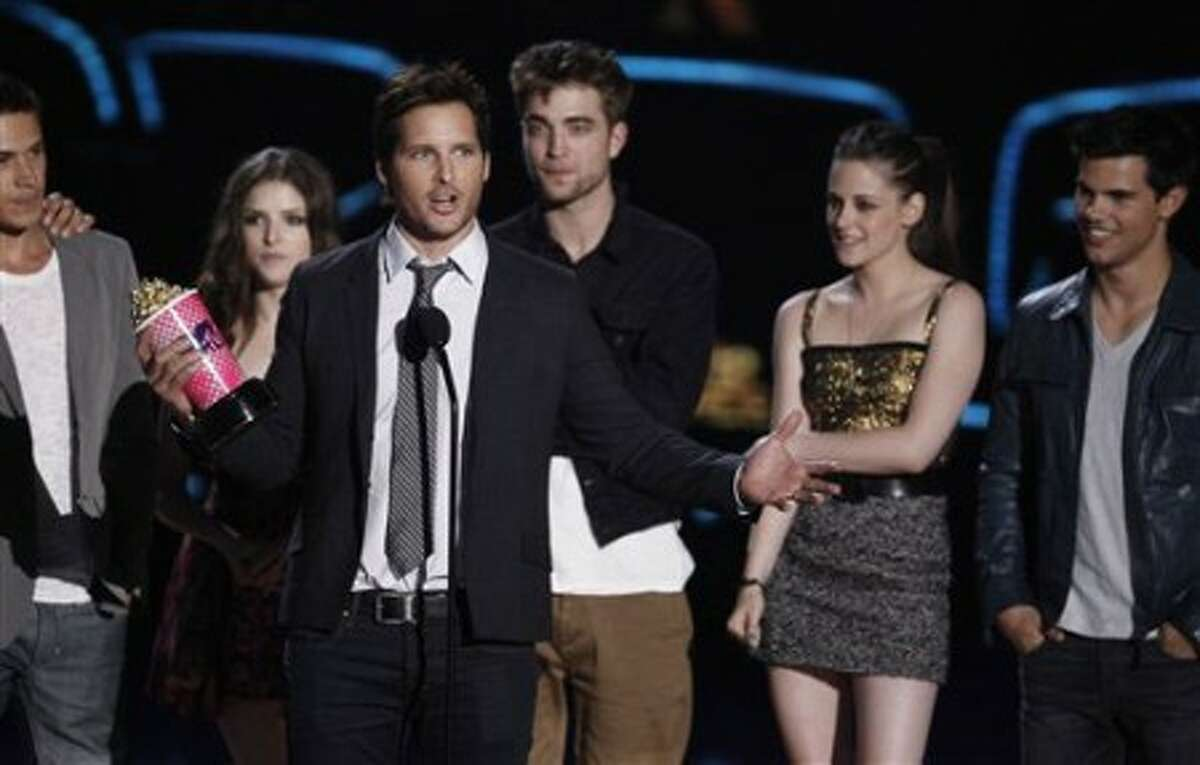 Peter Facinelli and members of the cast of The Twilight Saga: New Moon accept the best movie award at the MTV Movie Awards in Universal City, Calif., on Sunday, June 6, 2010. (AP Photo/Matt Sayles)