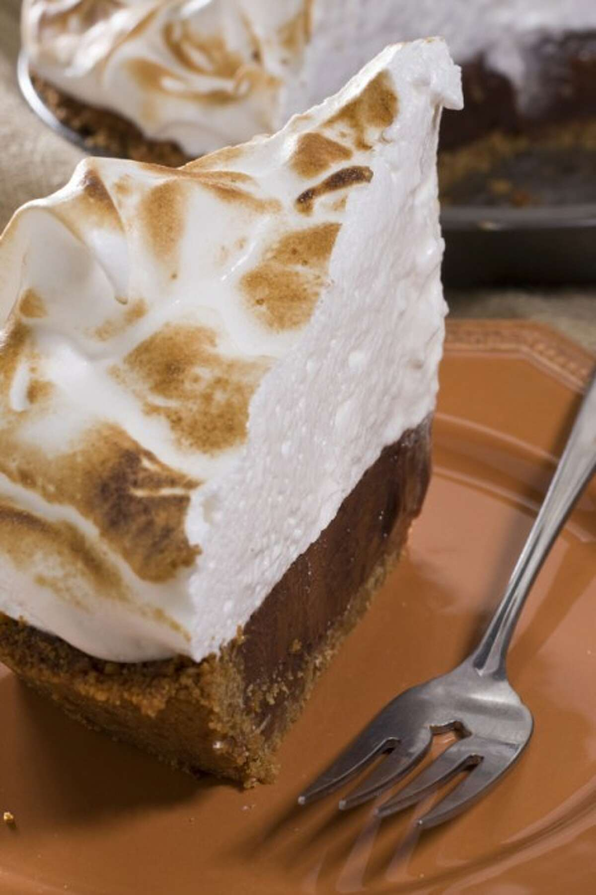 S'mores pie's fresh marshmallow topping gets browned with a small kitchen torch or can be broiled in the oven. (AP Photo/Larry Crowe)