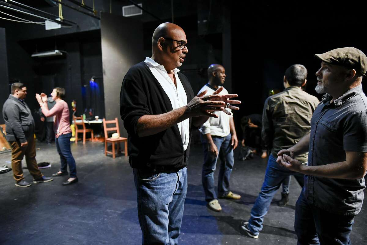 TheatreFirst's Jon Tracy (right) and Michael Torres talk at Berkeley's Live Oak Theatre.