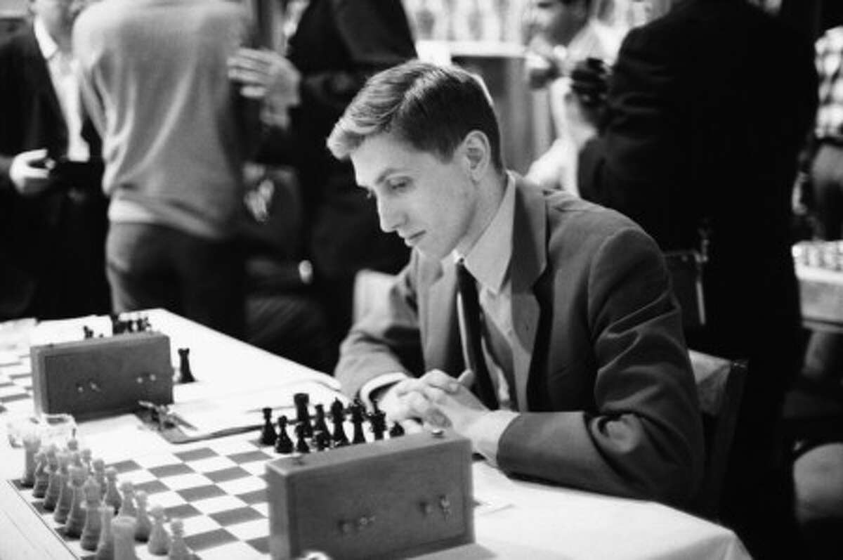 FILE - In this Dec. 22, 1965 file photo, Bobby Fischer attends the start of the U.S. Chess Championship tournament in New York. Authorities in Iceland exhumed the body of American chess champion Bobby Fischer to determine whether he is the father of a 9-year-old girl from the Philippines. Police district commissioner Olafur Helgi Kjartansson said Fischer''s corpse was dug up from a cemetery near Selfoss in southern Iceland early Monday, July 5, 2010 in the presence of a doctor, a priest and other officials. (AP Photo/JK, file)
