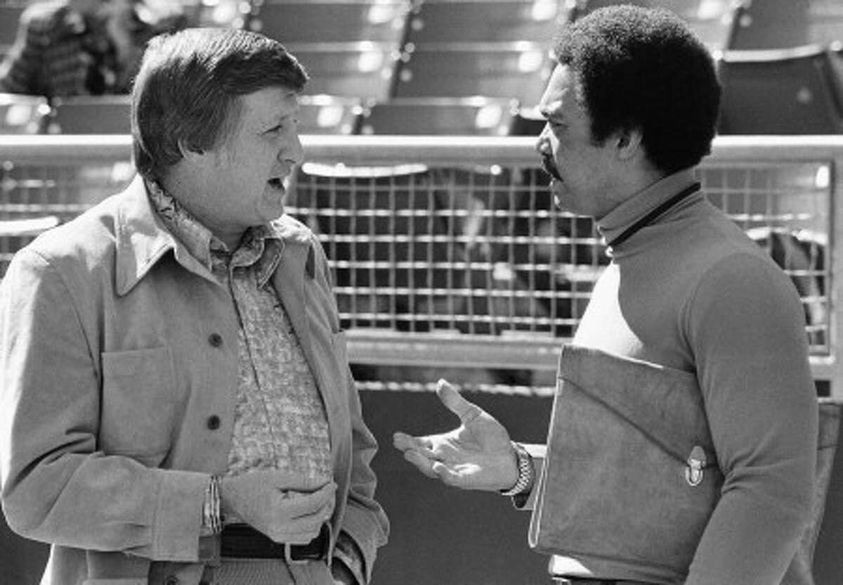 FILE - This Oct. 8, 1976 , file photo shows George Steinbrenner, left, principal owner of the New York Yankees, chatting with Reggie Jackson, now a free agent, at Royals Stadium in Kansas City. Steinbrenner, who rebuilt the New York Yankees into a sports empire with a mix of bluster and big bucks that polarized fans all across America, died Tuesday, July 13, 2010. He had just celebrated his 80th birthday July 4. (AP Photo/File)