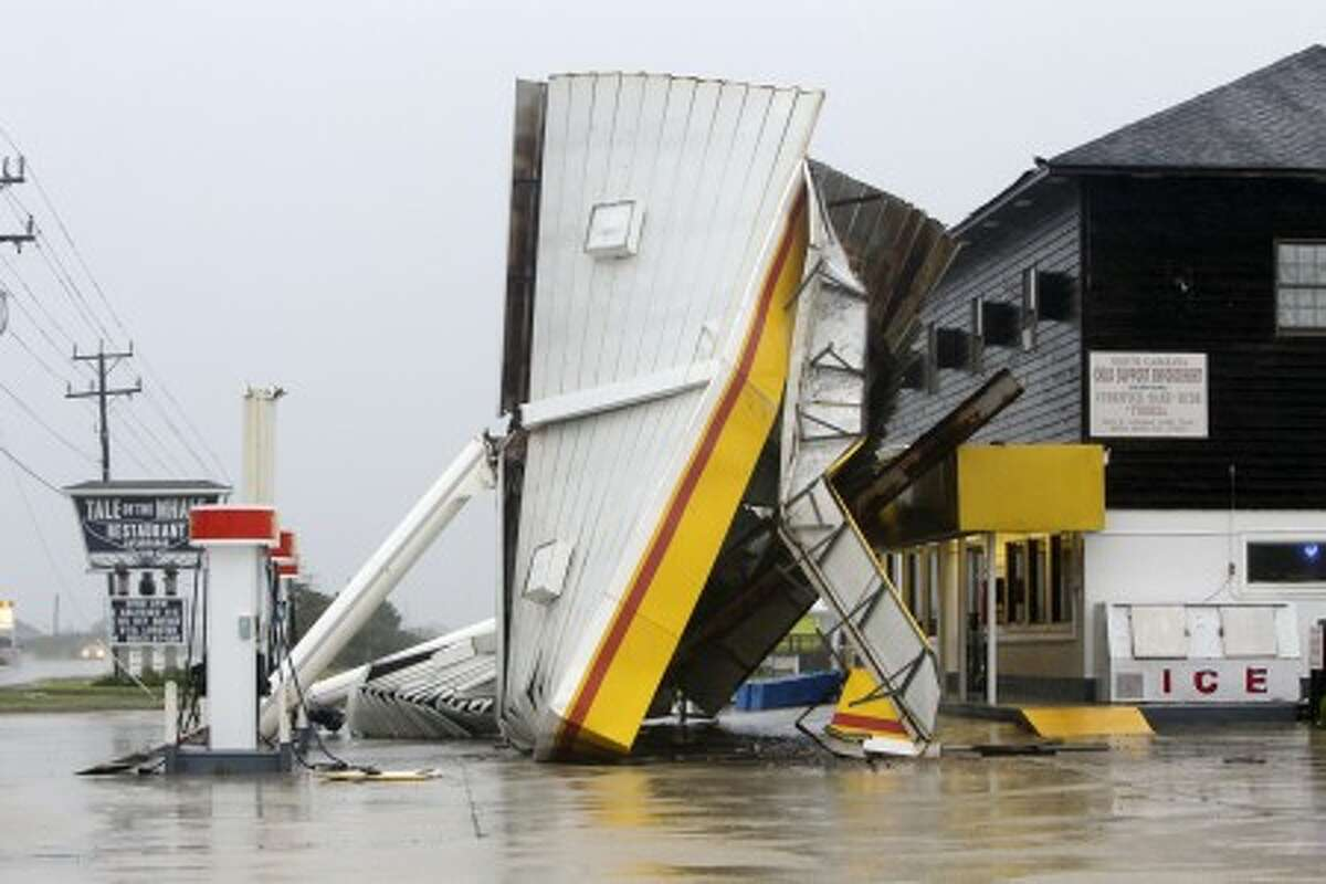 A metal roof is seen on the ground after winds from Hurricane Earl passed through overnight in Nags Head, N.C., Friday, Sept. 3, 2010. (AP Photo/Gerry Broome)