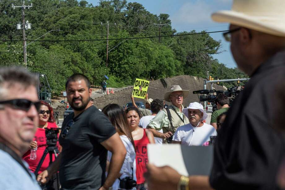 San Antonio, Texas -- June 17, 2016 --  People protesting Republican presidential candidate Donald Trump's visit to San Antonio gathered near his private fundraiser at Oak Hills Country Club. Ray Whitehouse/for the San Antonio Express-News Photo: Ray Whitehouse, Photographer / For The San Antonio Express-News