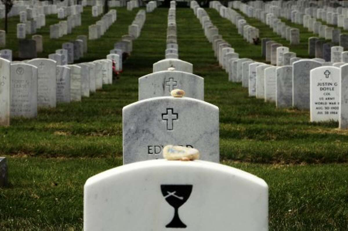 """Stones with the word """"hero"""" written on them lay on grave stones in Section 60, where many soldiers from the Iraq and Afghanistan wars are buried, Thursday,July 29, 2010, at Arlington National Cemetery in Arlington, Va. Estimates of the number of graves that might be affected by mix-ups at Arlington National Cemetery grew from hundreds to as many as 6,600 on Thursday, as the cemetery''s former superintendent blamed his staff and a lack of resources for the scandal that forced his ouster. (AP Photo/Jacquelyn Martin)"""