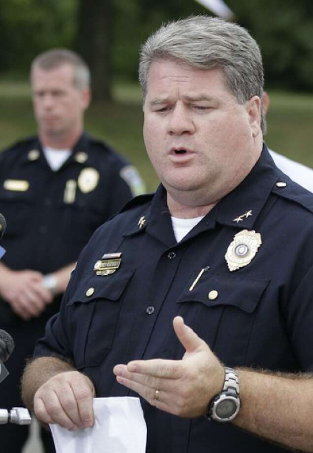 Manchester, Conn. Police Chief Marc Montminy answers reporters questions near the site of a multiple fatal shooting in Manchester, Conn., Tuesday, Aug. 3, 2010. A warehouse driver who was asked to resign his job at a beer distributor refused, then opened fire Tuesday morning, a company executive said. Police said the gunman and several other people were killed and others were wounded. (AP Photo/Charles Krupa)