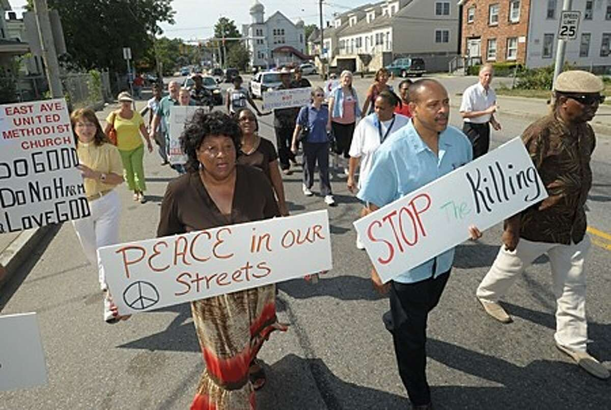 Local ministers Nellie Mann and Jeffery Ingraham organized a march down S. Main Street and a prayer vigil at The Norwalk Police Department headquarters Saturday calling for peace. Hour photo / Eik Trautmann