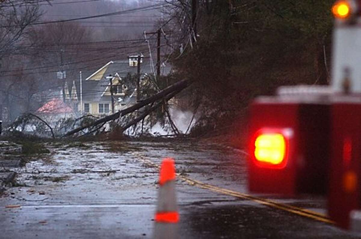 Norwalk Fire Department closes Spring Hill Rd after a tree brought down wires which burned for several hours. Hour photo / Erik Trautmann
