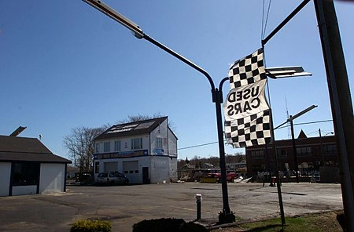 Wholesalers of America used car sales at 191 Main St. in Norwalk closed suddenly this week and all the cars on the lot were towed away. Hour photo / Erik Trautmann