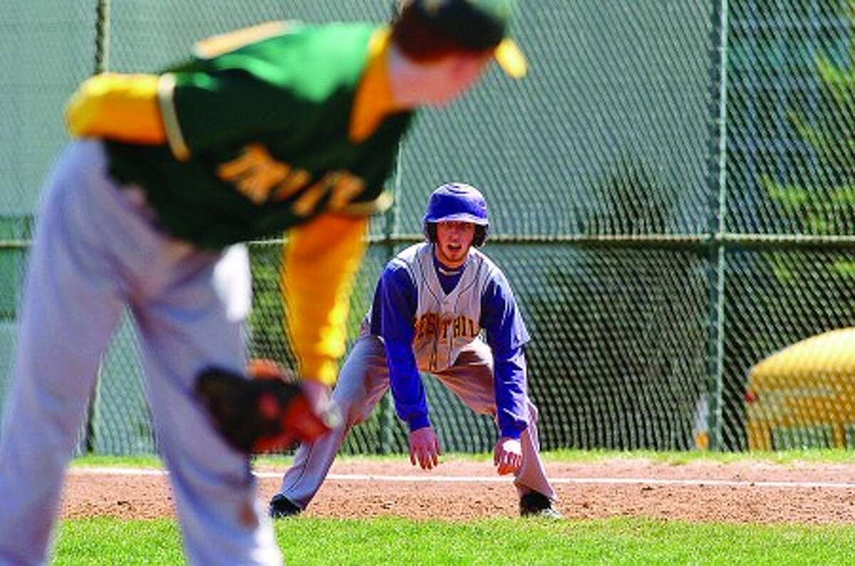 Westhill High baseball player Scott Valenzano, shown leading off first base against Trinity Catholic, has bounced back quickly from a throat ailment which threatened to keep him out of the lineup. Times photo/Erik Trautmann