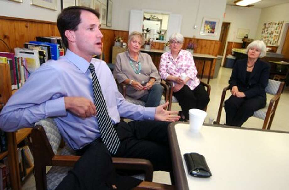 Photo/Alex von Kleydorff. Congressman Jim Himes answers a quetion and speaks with seniors during an Informational meeting at Wilton''s senior center on Monday
