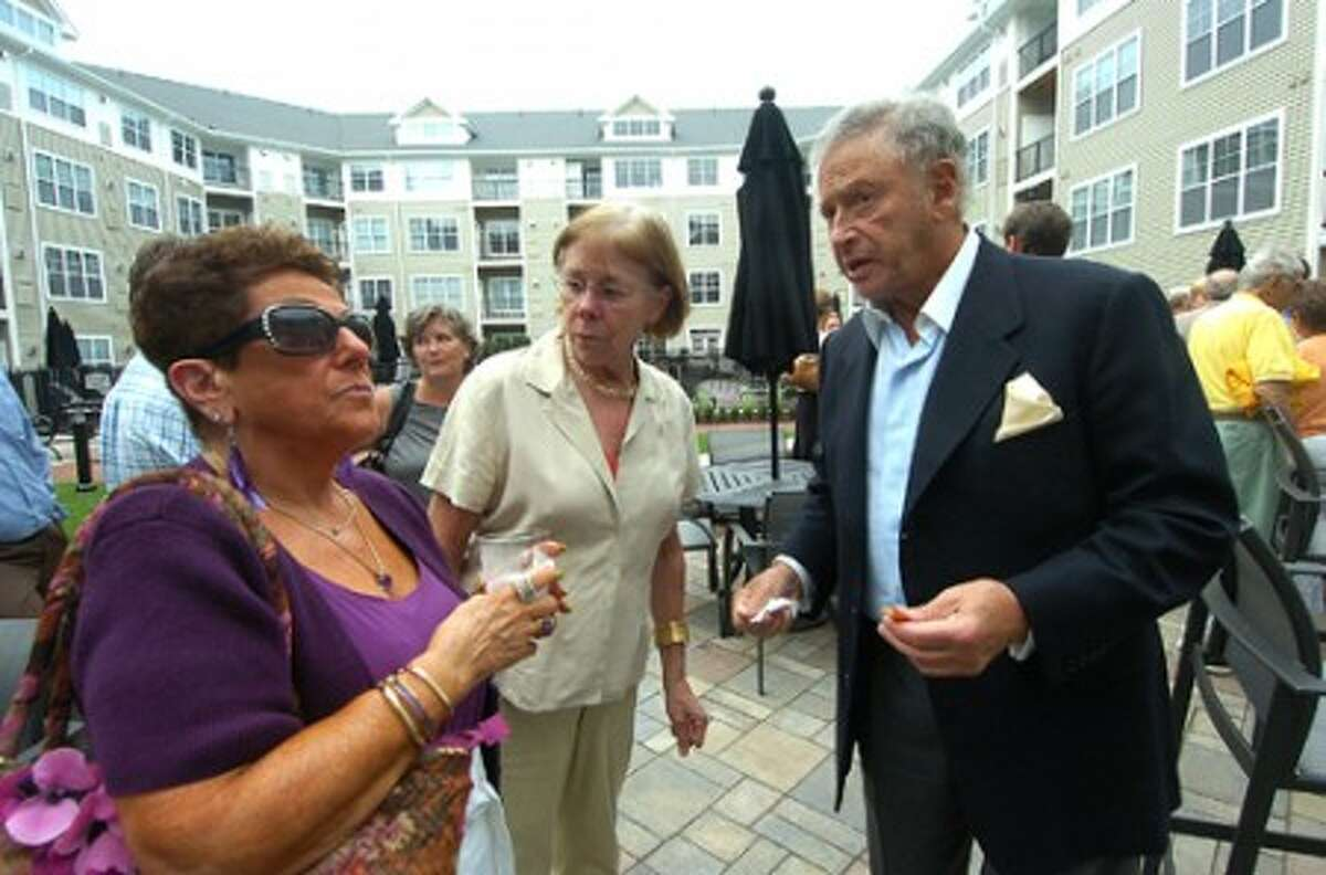 Photo/Alex von Kleydorff. L-R Carol Frank, Human Relations Chairperson, Susan Sweitzer, Reveleopment Sr. Project Manager and Stanley Seligson, of Seligson Properties enjoy the surroundings at the new Avalon of Norwalk complex during the Norwalk Redevelopment Agency''s party