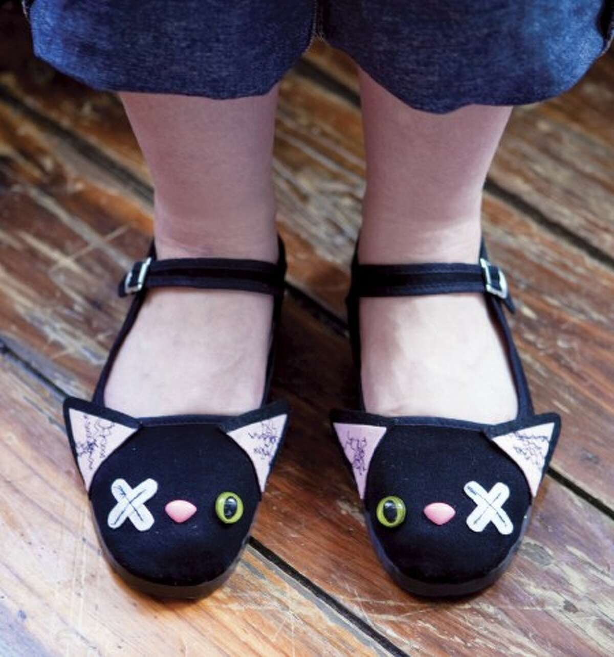 """This undated photo provided by Quirk Books/Steve Belkowitz shows a pair of slipper shoes transformed into """"zombie kittens,"""" courtesy of Lindsay Gibson of Em & Sprout and featured in the book """"Witch Craft,"""" Quirk Books, 2010. """"Witch Craft"""" is full of ideas for handmade accessories, decorations and treats. (AP Photo/Quirk Books, Steve Belkowitz) NO SALES"""