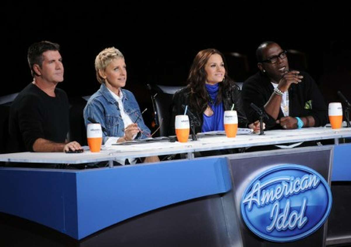 """In this undated publicity image released by Fox, """"American Idol"""" judges, from left, Simon Cowell, Ellen DeGeneres, Kara DioGuardi and Randy Jackson are shown. (AP Photo/Fox, Michael Becker)"""