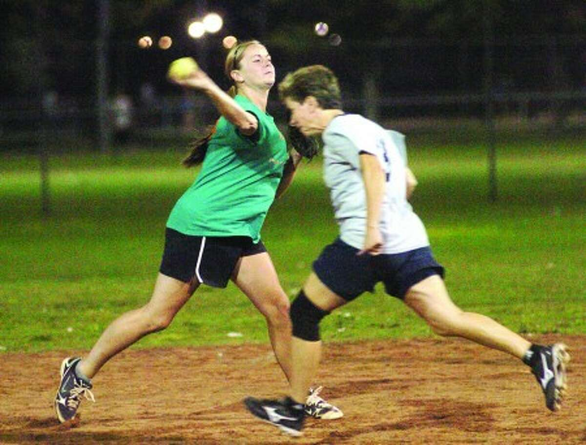 O''Neill''s #23 Breanne Morschauser and Partners Cafe #3 Margaret Giolitto in the women''s slow pitch softball finals at Calf Pasture Beach on Thursday. hour photo/matthew vinci