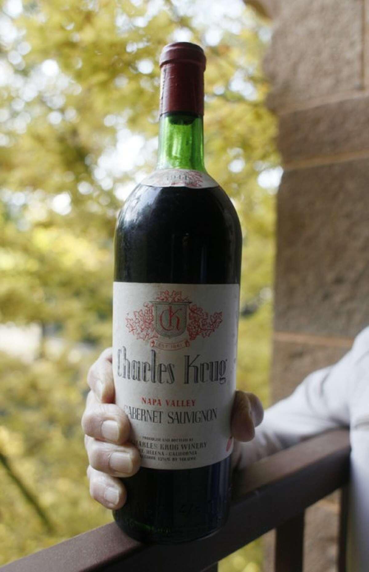 This photo taken Nov. 4, 2009 shows Peter Mondavi Sr. holding a bottle of 1944 Charles Krug Cabernet Sauvignon, the first his family produced.(AP Photo/Eric Risberg)