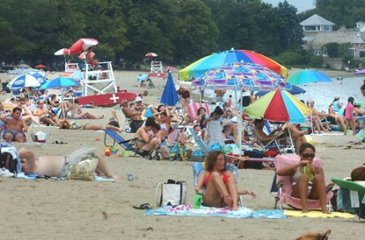 Photo/Alex von Kleydorff. A crowded Calf Pasture beach on Sunday.