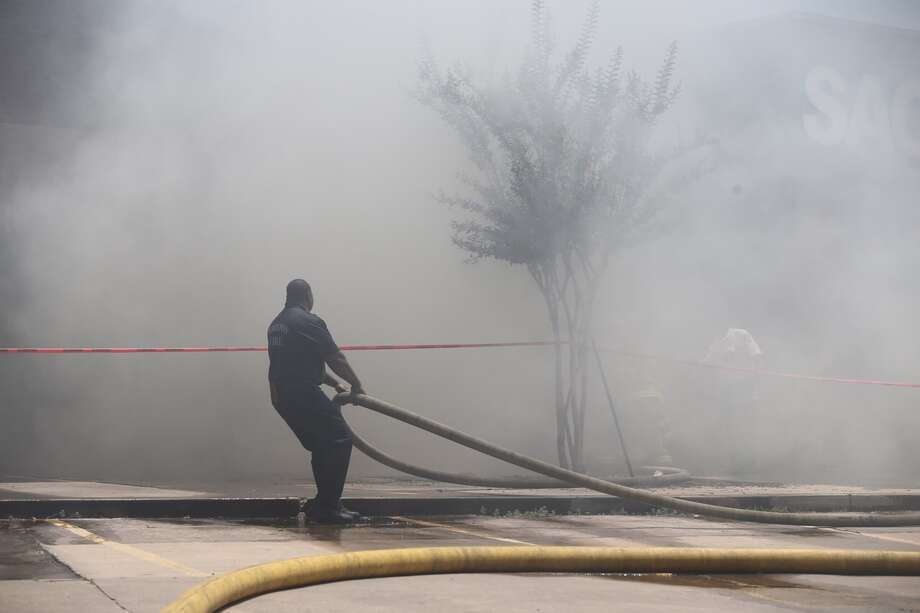 Firefighters are battling a large blaze Friday at a store in southwest Houston. Photo: Elizabeth Conley / Houston Chronicle