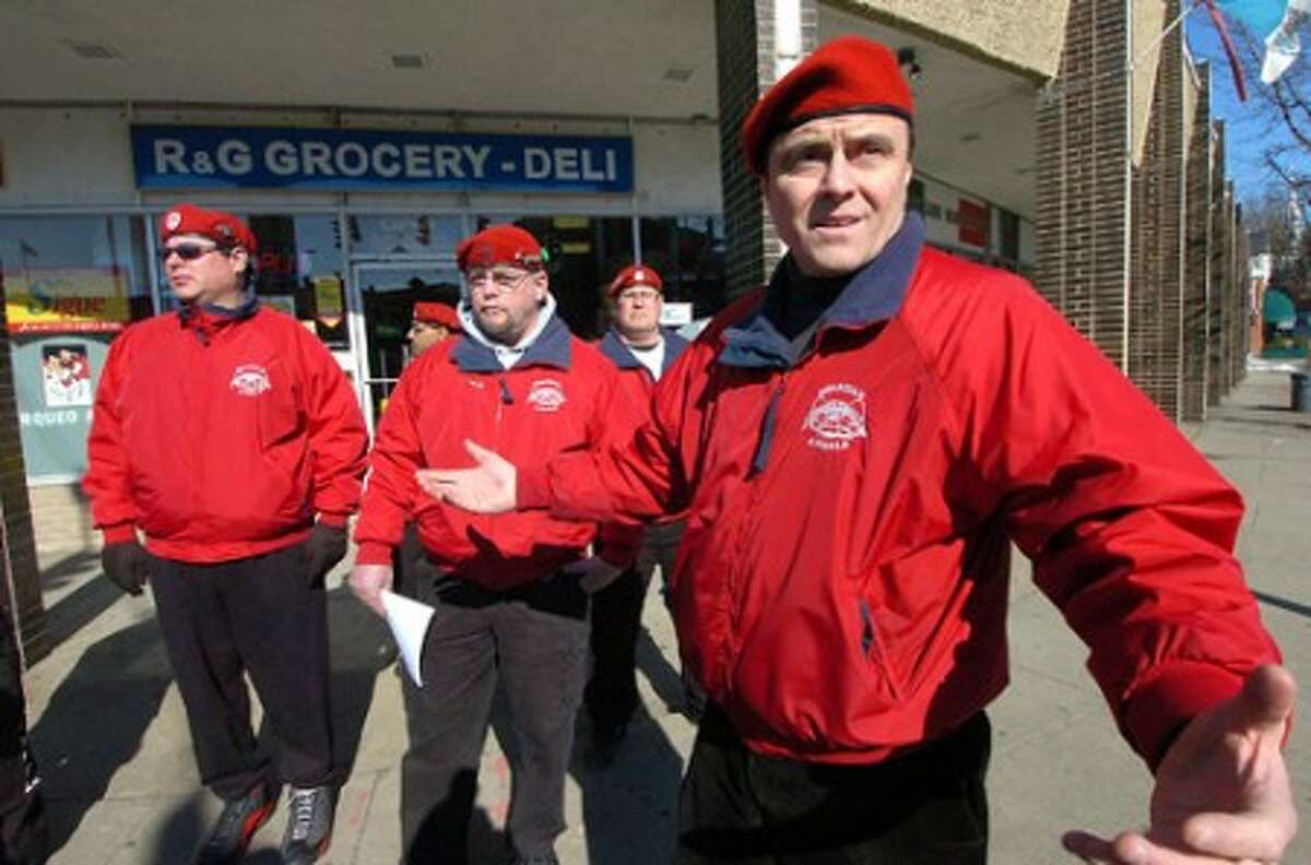 Photo/Alex von Kleydorff. Guardian Angels Founder Curtis Sliwa organizes a patrol at the corner of Main and Wall streets on Monday in Norwalk.