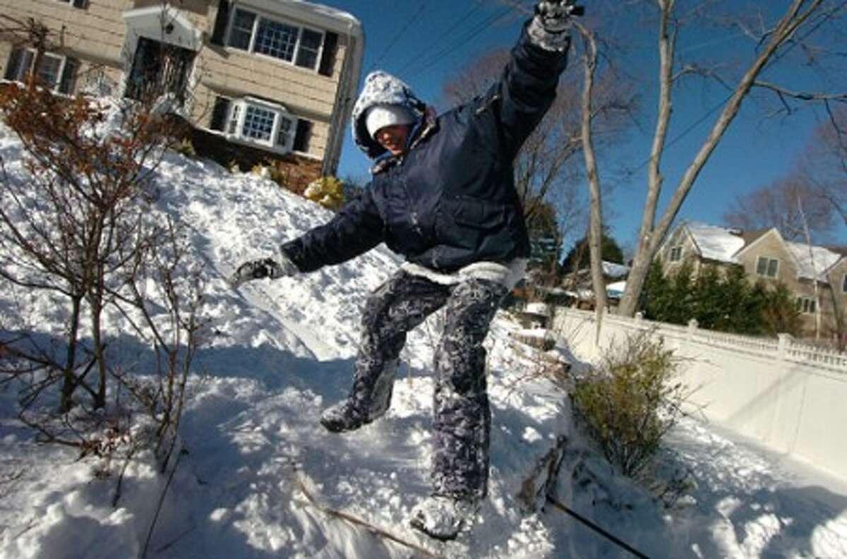 Photo/Alex von Kleydorff. 10 yr old Zach El-Tayyeb makes a run on his snowboard in his front lawn in Stamford.