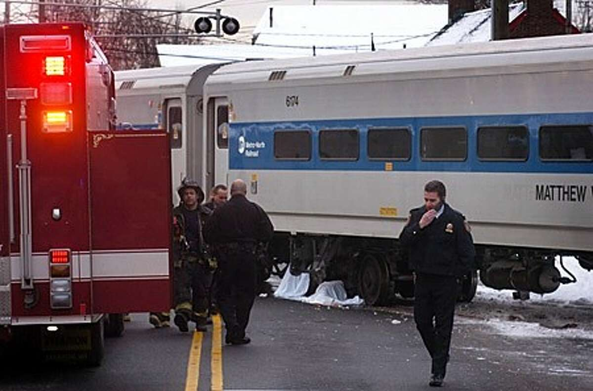 A pedestrian was struck and killed by a Metro North train on Commerce St in Norwalk Wednesday morning. Hour photo / Erik Trautmann