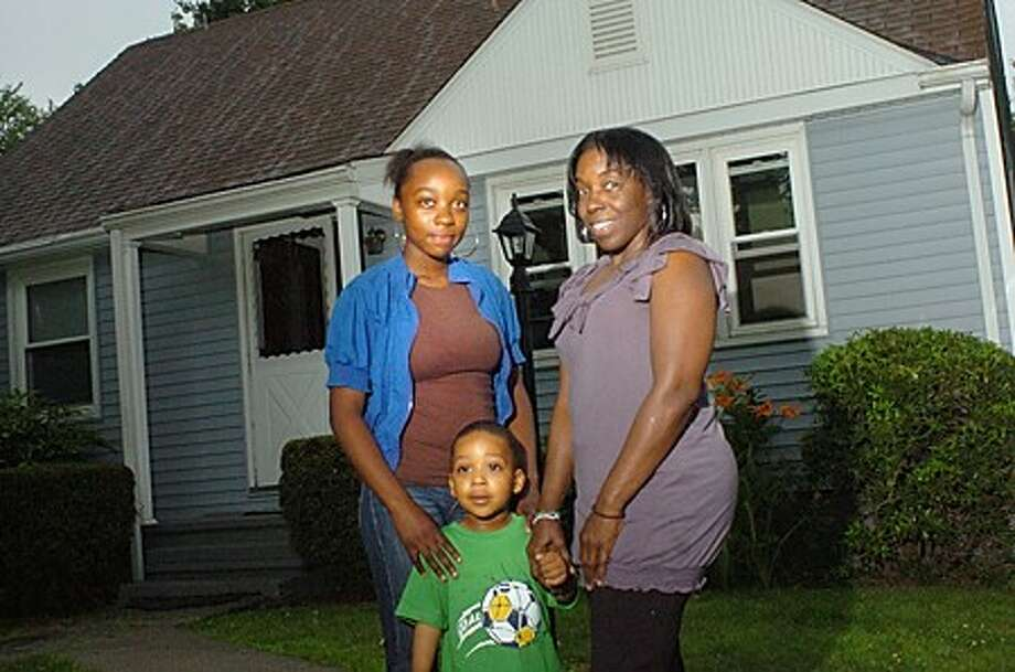 Sharon Walls is living in her own home on Walter street in Norwalk for the first time in 15 years, thanks to the help of a new program from NHA. She lives with her two grandchildren, Arianna Eason 12 and Nyjier 3. hour photo/matthew vinci