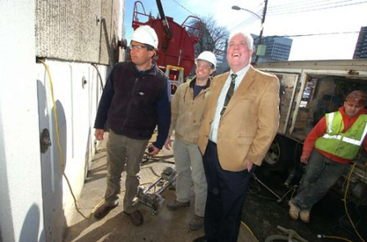 Photo/Alex von Kleydorff. Stamford family YMCA CEO Mark Ketley is shown where the new entrance to the building will be cut into by l-r Louis Gesualdi and Mike Danielle of Gesualdi Construction.