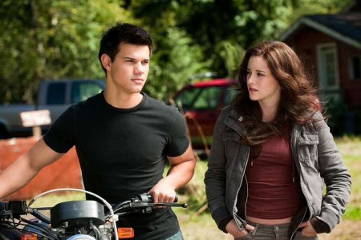 In this film publicity image released by Summit Entertainment, Taylor Lautner, left, and Kristen Stewart are shown in a scene from,