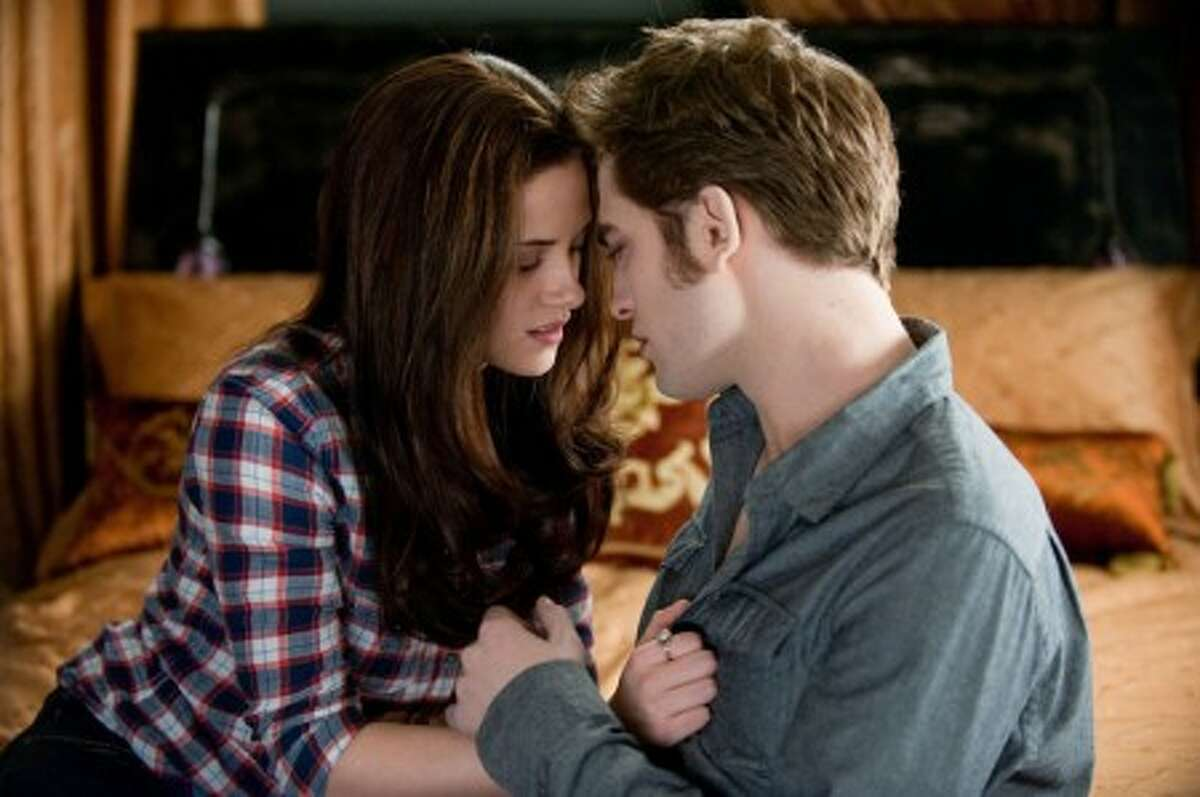 In this film publicity image released by Summit Entertainment, Kristen Stewart, left, and Robert Pattinson are shown in a scene from,