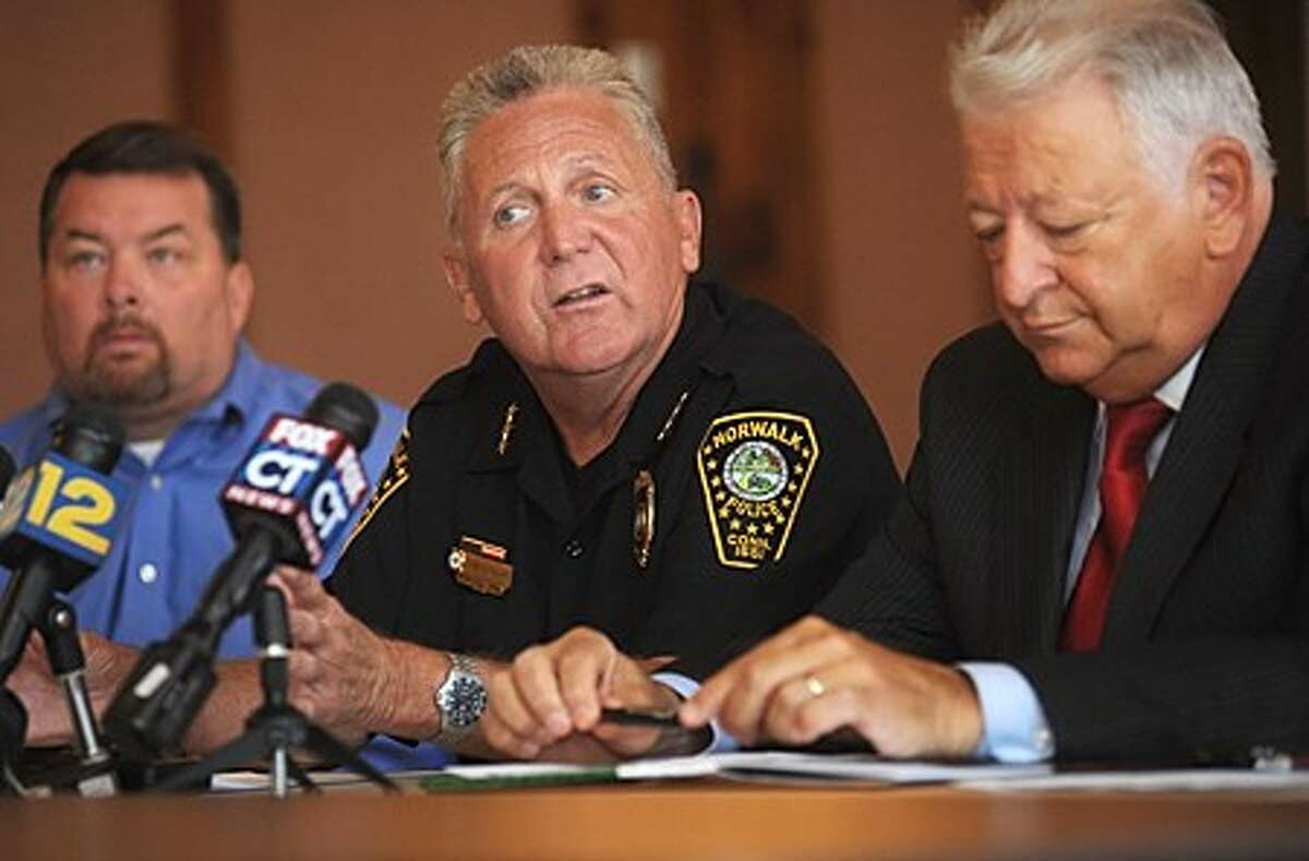 Norwalk Police Chief Harry Rilling, Lt. William Lowe and Mayor Richard Moccia hold a press conference at City Hall Thursday morning to comment on the recent gang related arrests and the other murder invertigations. Hour phoot / Erik Trautmann