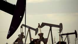In this April 24, 2015 photo, pumpjacks work in a field near Lovington, N.M.  Oil supply from the United States, Russia and other countries outside of OPEC is expected to drop sharply next year, possibly the steepest decline since the Soviet Union collapsed because of low prices, the International Energy Agency forecast Friday, Sept. 11, 2015.(AP Photo/Charlie Riedel)