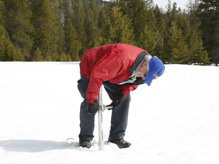 Frank Gehrke, chief of the California Cooperative Snow Surveys Program for the Department of Water Resources, checks the depth of the snowpack at Phillips Station near Echo Summit in March. Photo: Rich Pedroncelli, AP