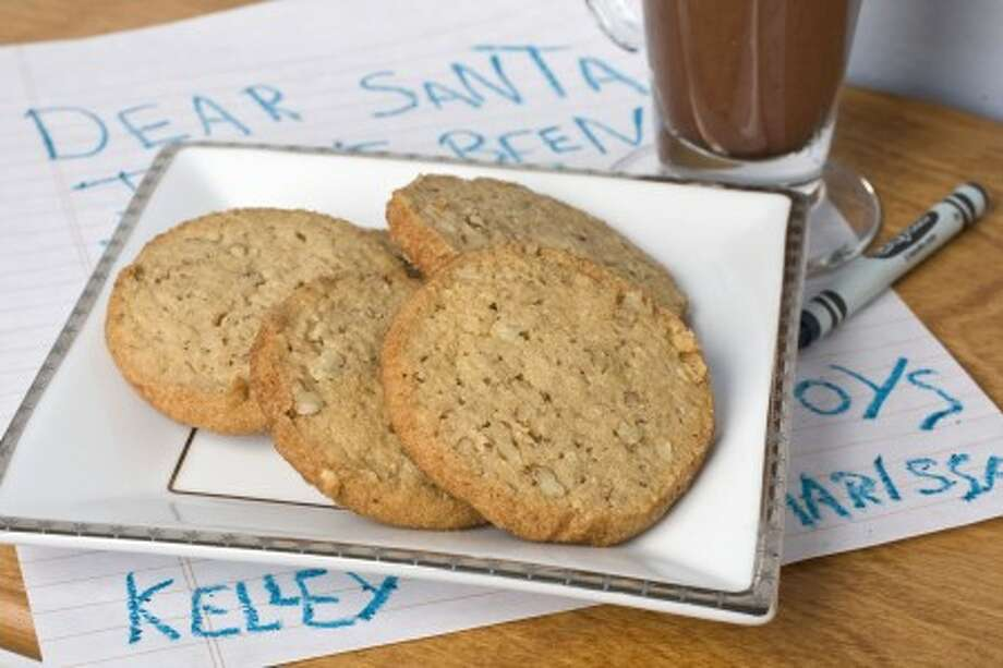 Pecan-cinnamon wafers are seen in Concord, N.H. These classic, crispy cookies are made with 100 percent whole-wheat pastry flour and are laced with healthy, monounsaturated fat-rich pecans. (AP Photo/Larry Crowe)