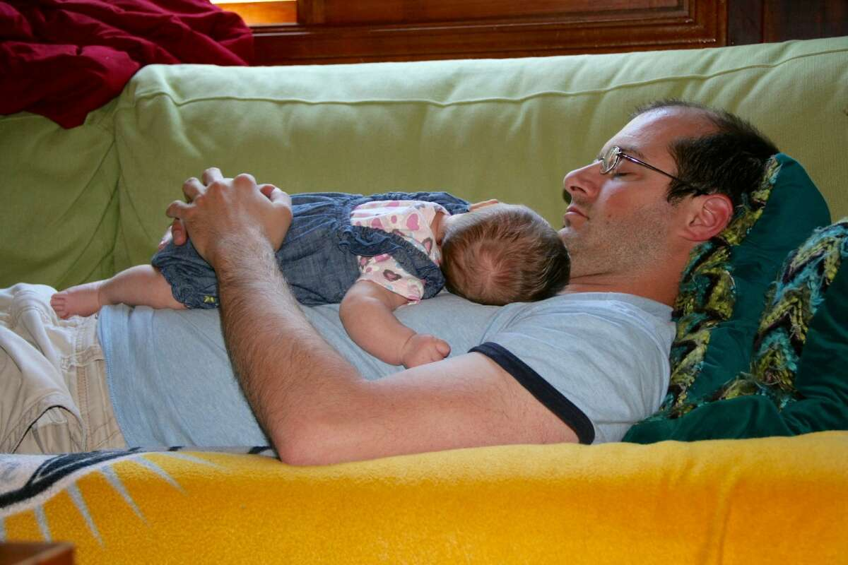 Dad and baby catching some shut-eye.