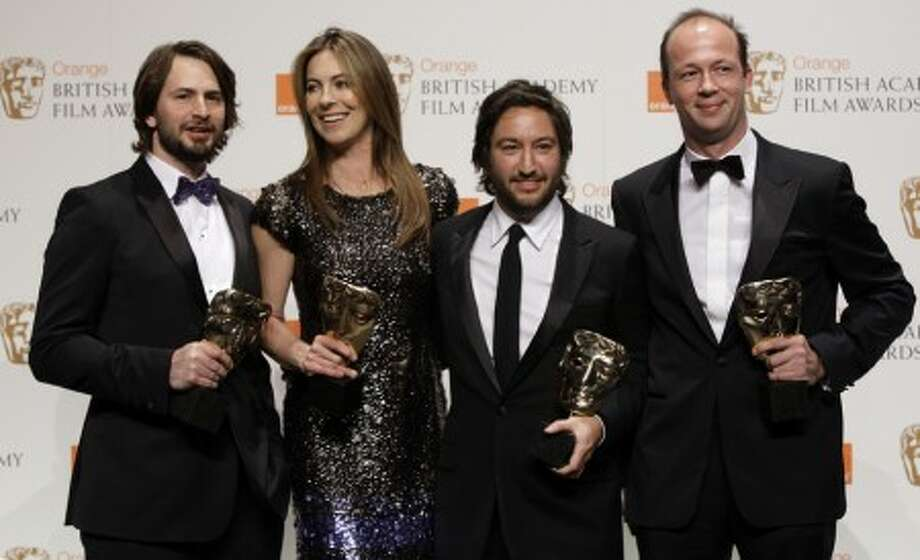 From left to right, US screeenwriter Mark Boal, US director Kathryn Bigelow, producer Greg Shapiro and French Nicolas Chartier, pose for the photographers with their awards for Best Film with their latest film '' The Hurt Locker'', in the media room at the British Academy Film Awards 2010 at The Royal Opera House in London, Sunday, Feb. 21, 2010. (AP Photo/Joel Ryan)