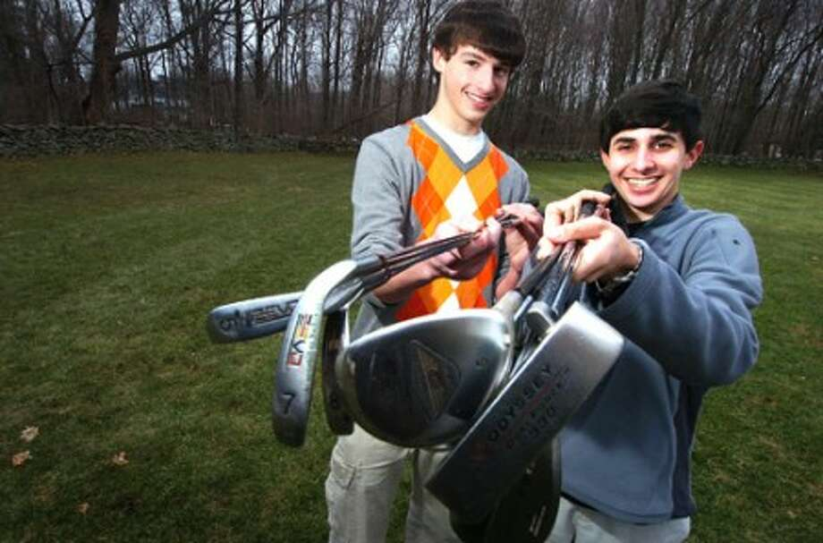 Photo/Alex von Kleydorff. L-R Bryan Richman and Brad Vonick and just a few of the donated golf clubs they have collected.