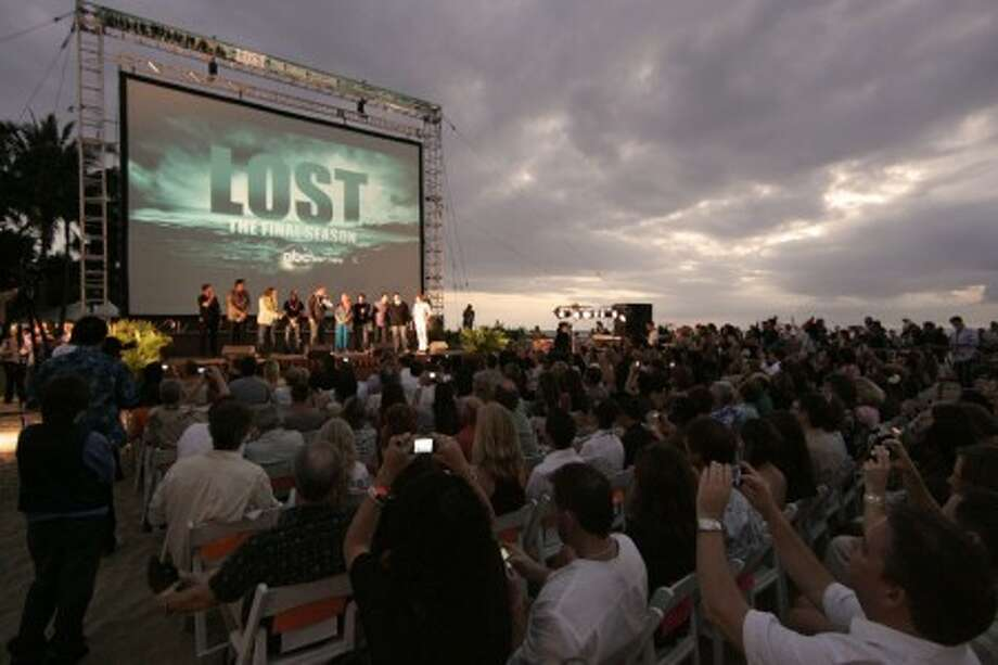 Beach goers are seen at the Lost Premiere on Waikiki Beach, Saturday, Jan. 30, 2010 in Honolulu. Lost, which is filmed in Hawaii, returns to television for its sixth and final season Tuesday. (AP Photo/Marco Garcia)
