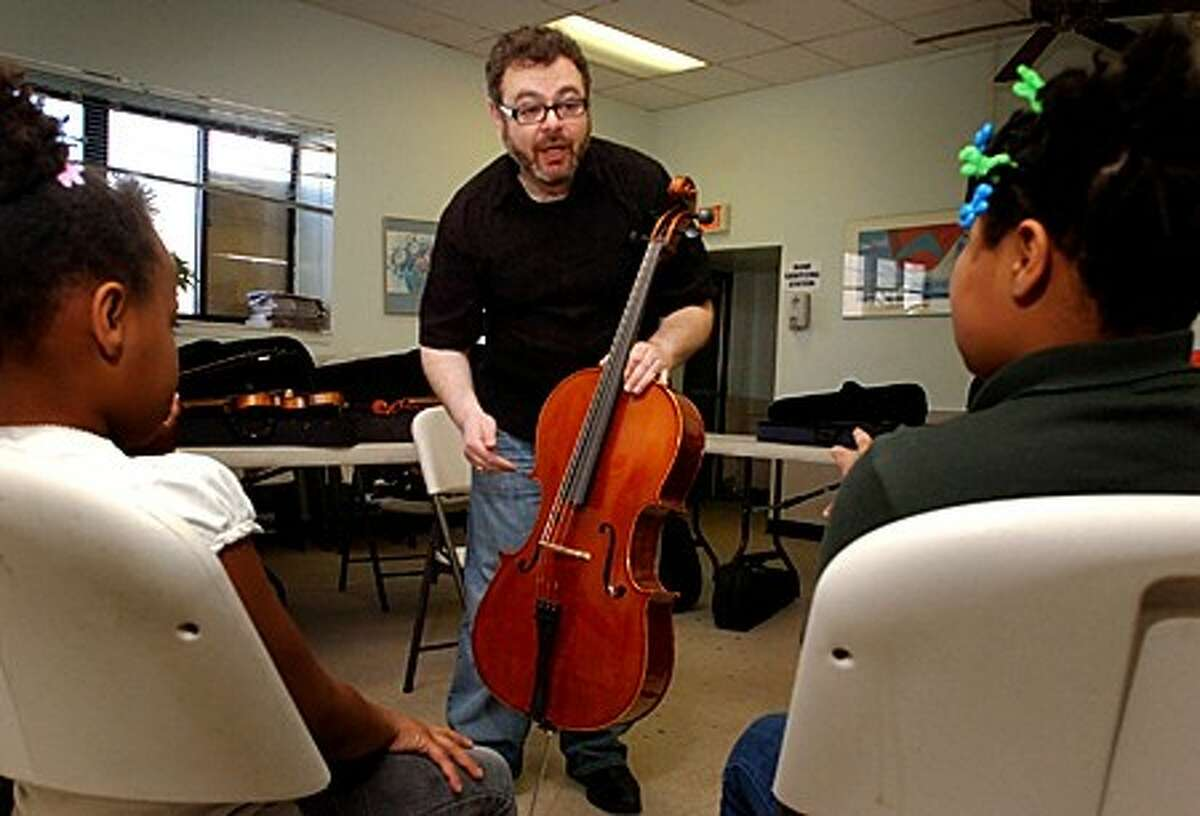 Isla Levitin is a Norwalk cellist who volunteers his time on Saturday mornings to teach homeless children how to play string instruments. Hour photo / Erik Trautmann