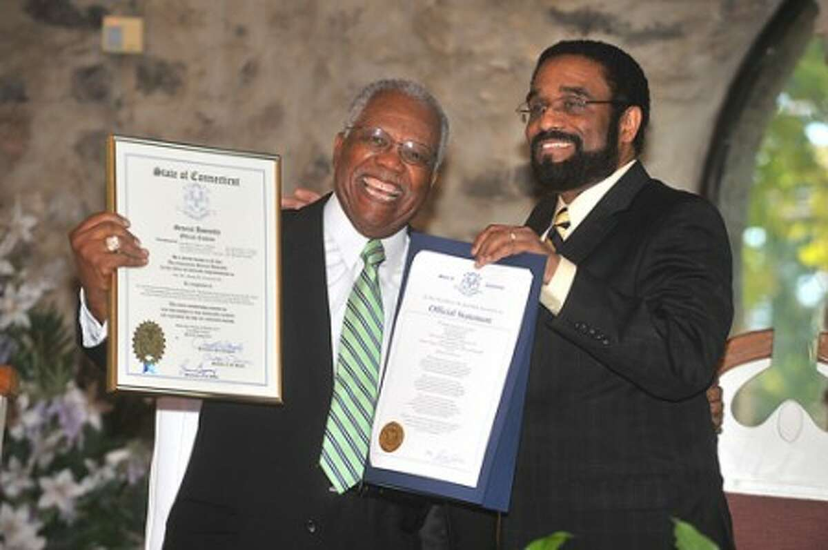 Photo/Alex von Kleydorff. Rev. Dr. Joseph Clemmons Sr. is presented with two citations from Bruce Morris, one from Gov. Rell and another from The Connecticut General Assembly honroring him for his service