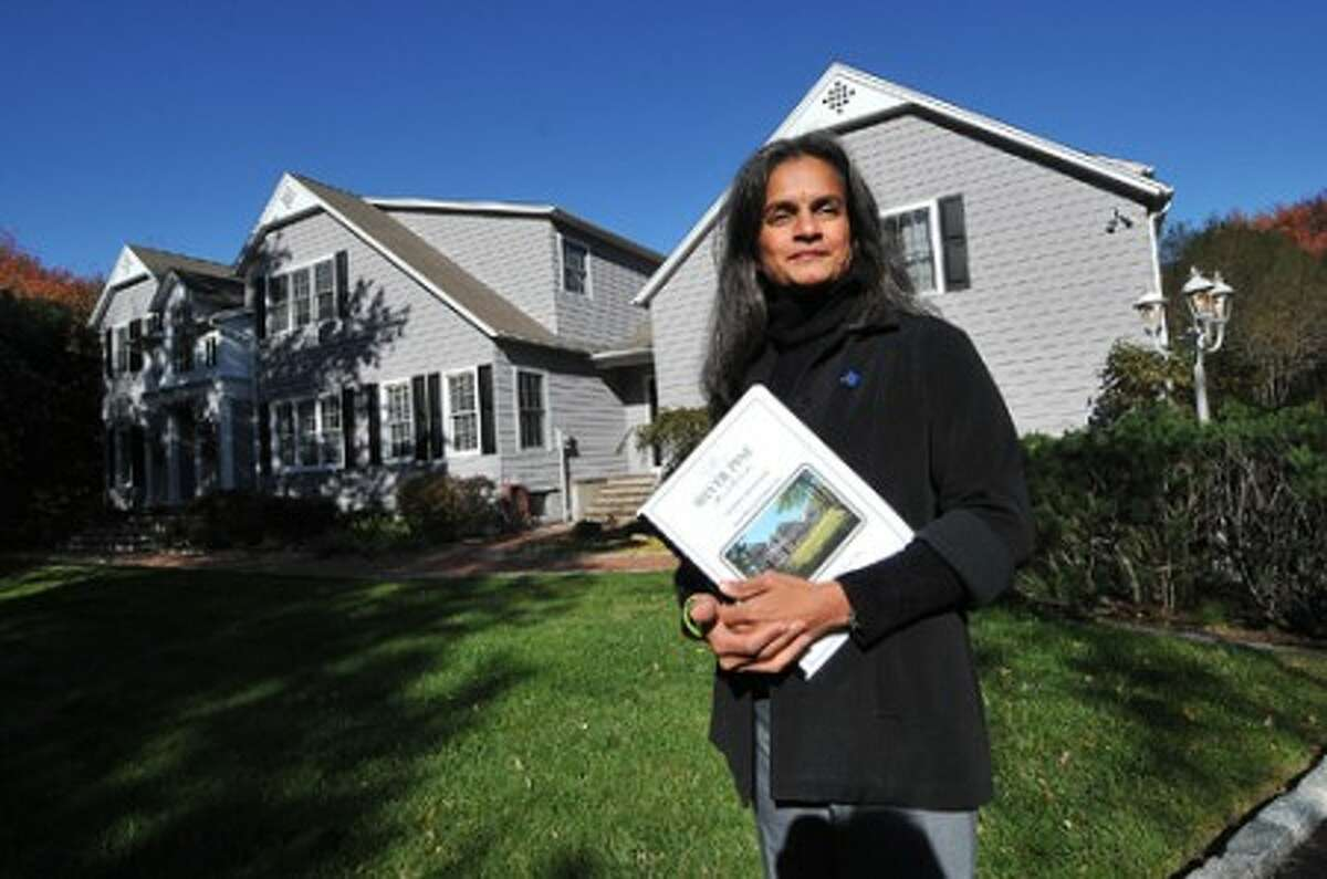 Shalini Madaras and Silver Pine Real Estate at a house for sale on Duck Pond Rd. in Wilton.