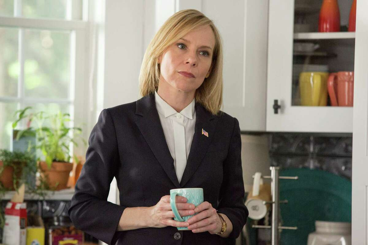 """This image released by Warner Bros. Entertainment shows Amy Ryan in a scene from, """"Central Intelligence."""" (Claire Folger/Warner Bros. Entertainment Inc. via AP)"""