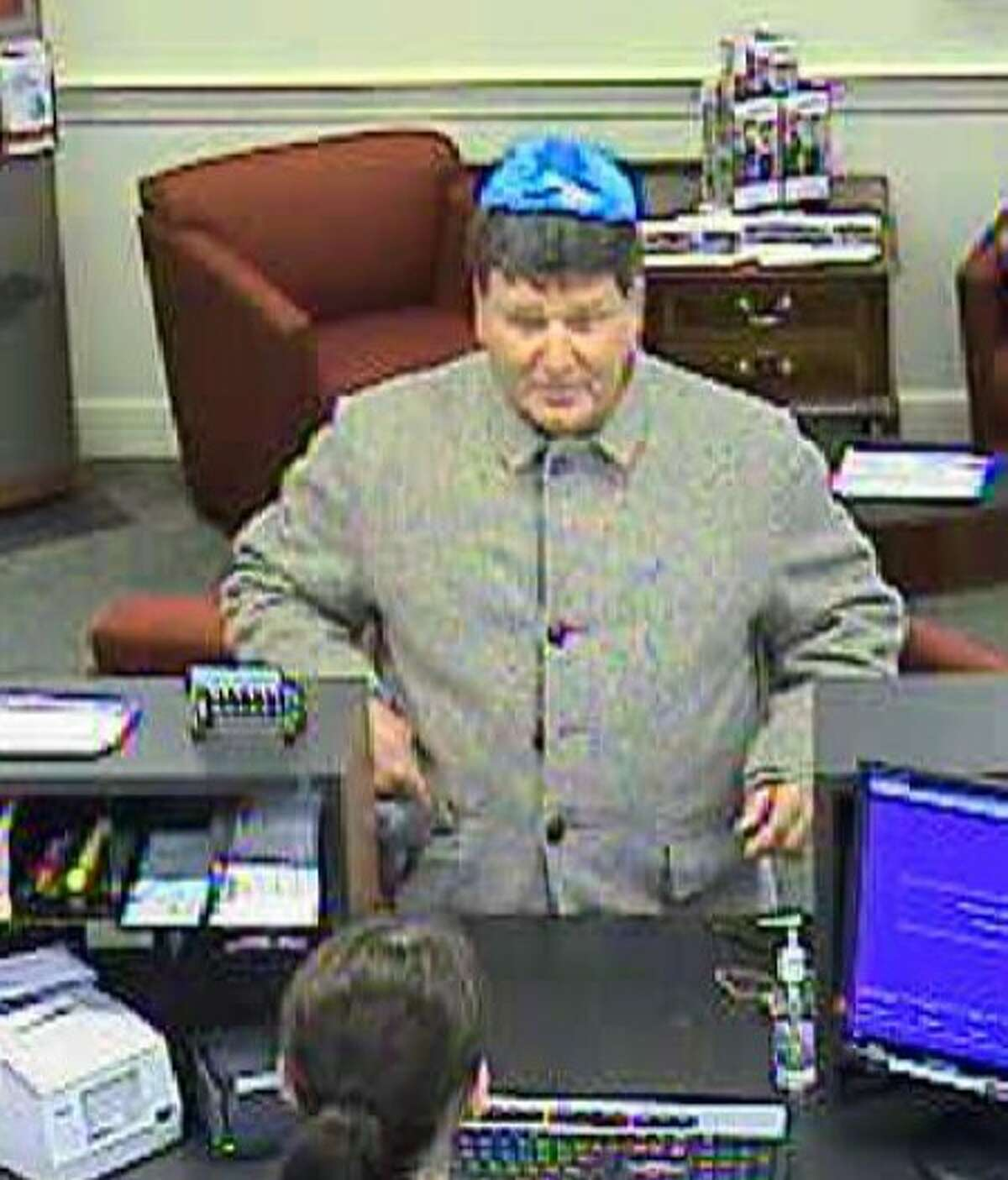 Police search for Darien bank robber
