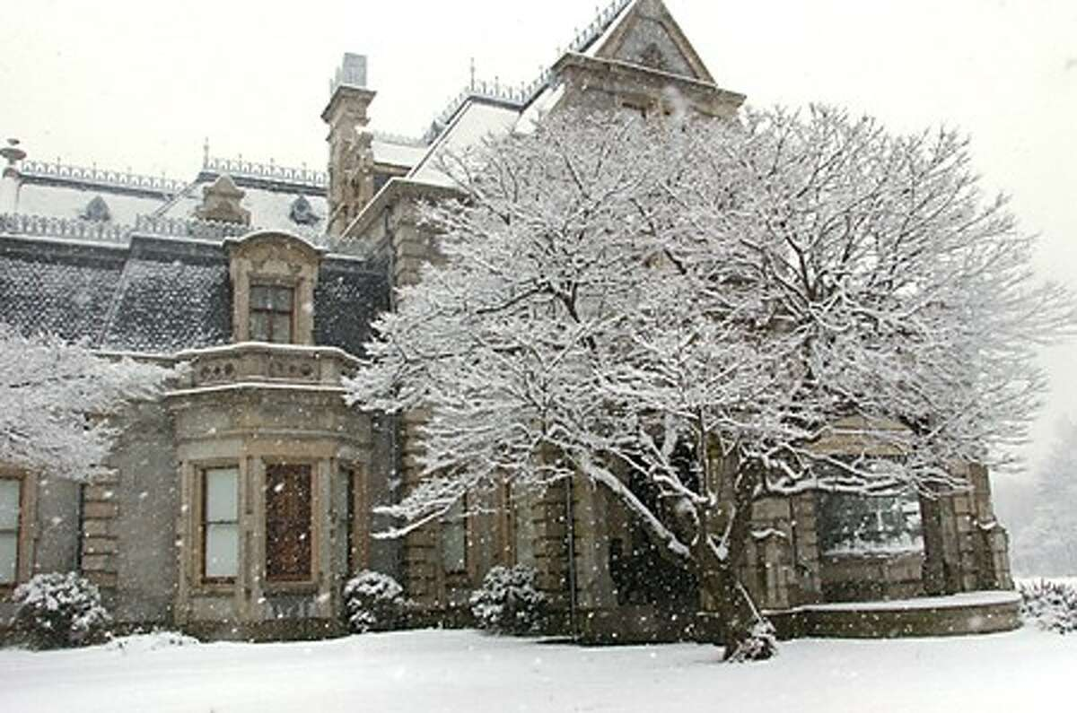 Unexpected snowfall blankets the grounds at the Lockwood Mathews Mansion Museum Thursday morning. Hour photo / Erik Trautmann