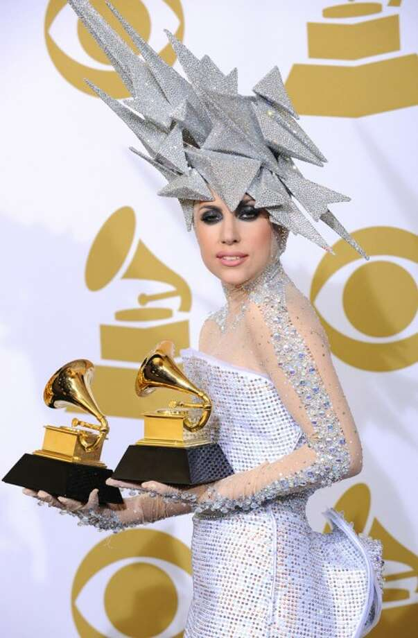 Musician Lady Gaga poses backstage with her awards for Best Dance Recording and Best Electronic Dance Album at the Grammy Awards on Sunday, Jan. 31, 2010, in Los Angeles. (AP Photo/Matt Sayles)