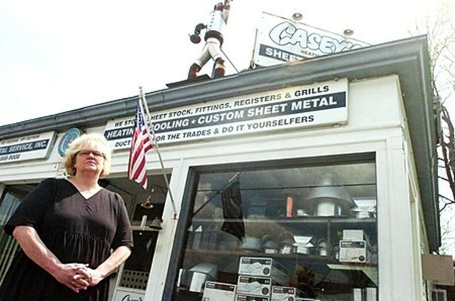 Nancy Esposito, owner of Casey''s Sheet Metal is filing a lawsuit over a written deal with Stanley M. Seligson Properties regarding relocating her buisness. hour photo/matthew vinci