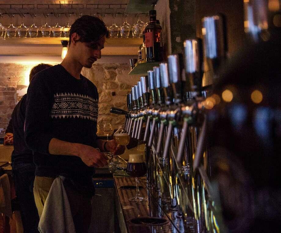 A bartender works the taps at La Fine Mousse, a bar in Paris that focuses firmly on craft brews. Photo: Nono La Mine