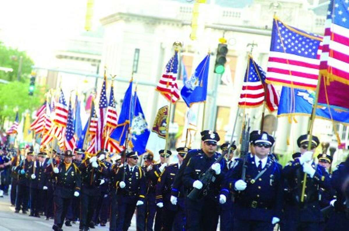 Over 500 officers from more than 30 Police Departments throughout the Northeast participated in the Police Week Parade in Stamford Thursday. hour photo/matthew vinci